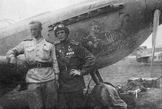 SOVIET AVIATION in the years 1941-1945 WW2. Soviet pilot Georgy Bayefsky (right) and mechanic Sobakin on background of Yak-9U. 5 GvIAP. Shprotau Airfield, Germany. April 1945