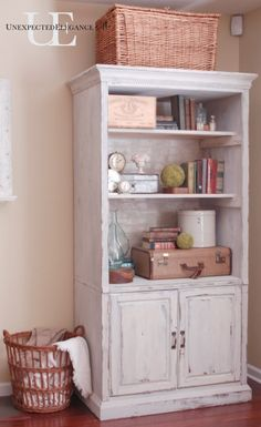 Turn an old, outdated media cabinet into a bookcase for displaying.