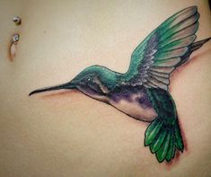 Hummingbird is a small cute bird with affinity for flowers and sweet life. Hummingbird Tattoo Designs is a hot topic for US girls. Tiny Hummingbird tattoo on neck and back looks awesome and get more attention then any other part of body. Well some of the following images of hummingbird tattoos might be interesting for you. Because they are latest designs ideas for women. They may also be for men depending upon style. Humming bird tattoo drawing could be done with watercolor, ink, or any