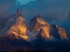 """Mountains, Chile  Photograph by Richard Duerksen, Your Shot """"We have mountains,"""" my wife said as she shook the bed. We were staying in a B&B on the edge of Chile's Torres del Paine National Park. There was only fog instead of mountains. I set up my cameras anyway and pointed them toward the park. Art happens when light and shadows play on granite and snow."""