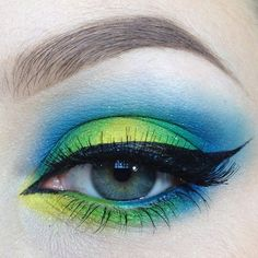 Fun with @sugarpill today. Shadows are #buttercupcake #acidberry #midori #afterparty #velocity #hiviz #sparkage and #tako. #afterparty and #acidberry on the waterline. Lashes are 105 from @ardell_lashes. Liner is from @elfcosmetics. Brows are #dipbrow in #blonde and #chocolate with clear brow gel from @anastasiabeverlyhills. #sugarpill #ardelllashes #ardell #elfcosmetics #anastasiabeverlyhills #abhcosmetics #anastasiabrows #eotd #motd #yellow #green #blue