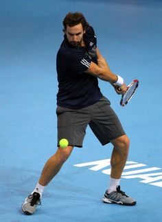Ernests Gulbis Photos - Ernests Gulbis of Latvia in action during the men's singles semifinal match against Julien Benneteau of France during the Malaysian Open at Putra Stadium on September 2014 in Kuala Lumpur, Malaysia. Kuala Lumpur, The Man, Sporty, Running, Photos, Men, Style, Racing, Swag