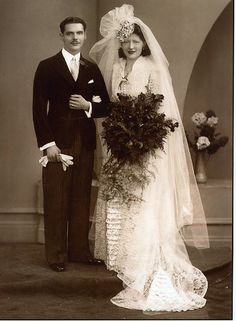 1943 English bride and groom ...awesome headpiece.