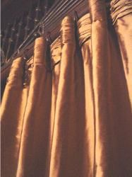 Tightly ruched and pleated curtain tops.  More structured than the typical ruching.