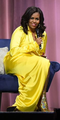During her eight years in the White House, Michelle Obama redefined what a First Lady dresses like. Now that the presidency is behind her and her family, Obama has tapped further into her sartorial creativity. Her most recent outfit is a case in… Michelle Obama Fashion, Barack And Michelle, Michelle Obama Yellow Dress, Anna Wintour, Barack Obama, Bota Over, Balenciaga Boots, Yellow Gown, First Black President
