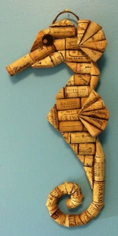Cork wall hangings are all hand-cut, drilled and wired from a variety of recycled corks. Each piece is backed with a sheet of cork and wired and ready for hanging and some include hand-painted...