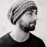 This for the young fashionable man or women. Looks great with a pair of jeans and a plain top. ideal for festivals and concerts. Hand crocheted slouchy beanie hat in 100% acrylic yarn which is suitable for all year round Made in a stripey pattern in mi...