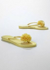 "Fun and versatile flip flop, great for changing into after a long night of dancing.  Comfortable flip flop features flower on the front and matches back to many bridal dresses.  Available in Canary, Ivory, Guava, Malibu and White.  Satin upper with matching cushioned sole and 1/2"" heel. Available in sizes S (5/6), M (7/8), L (9/10), and XL (11/12).  Imported.   *Buy one pair, get the second pair 50% off! Discount taken in cart."