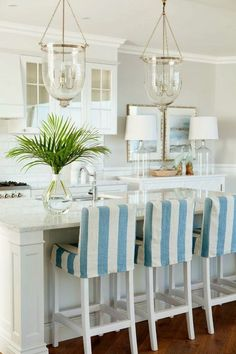 Love the light blue nautical stripes on these bar stools!