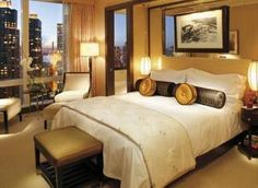 Located at the top of Time Warner Center, this hotel is 1 block from Central Park. It features a 75-foot indoor pool and offers rooms with panoramic views of Manhattan. Every modern room at Mandarin Oriental New York features floor-to-ceiling windows. Guests can enjoy the 36-inch flat-screen TV with surround sound and a DVD player. A minibar is included along with a chocolate and bottle of Fiji water provided each day. The Oriental Mandarin offers a full-service spa with a sauna an...