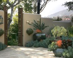 I will build an earthbag fence/wall... oh yes, curvy and monolithic, just like the Eclectic Santa Fe Style Design, Pictures, Remodel, Decor and Ideas - page 16