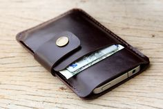 Mini soil dark brown leather iphone/wallet case.  I should get this for Jon when his current leather money clip bites the dust.