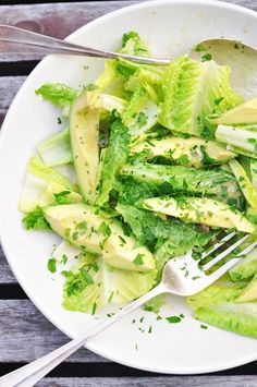 Make a simple salad with large avocado slices, leafy greens, olive oil, lemon juice, garlic, salt, pepper, and a some herbs.