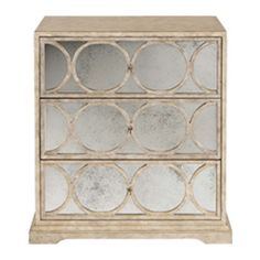 Three drawer nightstand with antiqued mirror  behind wood fretwork at Cabana Home