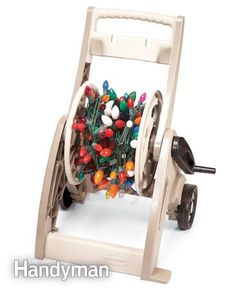 Holiday Decorating Tips - use a hose reel to store Christmas lights