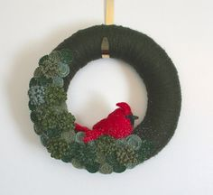Green and red cardinal wreath, 12-inch size. This wreath is ready to ship. So fun for those dreary winter days! Ive wrapped a 12-inch straw