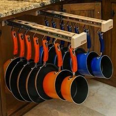 A new storage solution from Glideware revolutionizes your kitchen cabinets by letting you organize all your pots and pans vertically. This award-winning product is also available for closets.