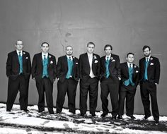 turquoise, black, and white.  Switching the groom and groomsmen vests though