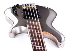 If you're looking for versatility without sacrificing tone, this PRS Gary Grainger 5 String Bass in Custom Color Pewter is the bass for you. This thing can tackle in-your-face, bass-centric funk just as well as it can handle warm, vintage tone that glides along underneath everything.