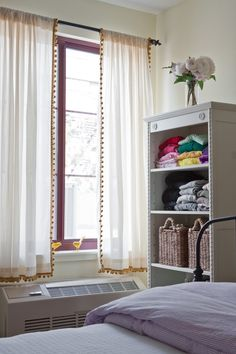 add ball fringe (pom poms) to plain white curtains