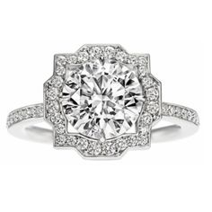 This is the engagement ring of my dreams. But it's Harry Winston, and a liiiittle bit expensive. But the quatrefoil makes it perfect for a Phi Mu girl! And it is BEAUTIFUL.