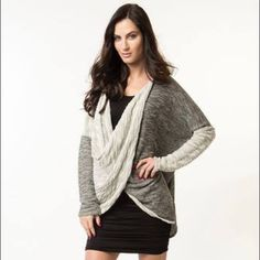 """Wrap Twist Sweater Great top in shades of grey!  New condition only washed once to release """"new fabric lint"""".  Tried once or twice from clothing styling kit.  I have one of these myself and love it!  I wear mine all the time.  Size is marked medium with a loose fit.  So this will will work for a S-XL  Holds // PayPal // Drama // Comment Negotiations Respectful Offers Encouraged with Offer Button or Negotiation Post // Trades Selectively // Bundles Winnie & Kat Sweaters Shrugs & Ponchos"""