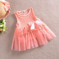 Robe bébé pour cérémonie, rose saumon.