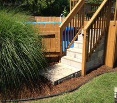 concrete steps wood deck and landscaping around above ground pool