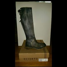 """Brand new/never worn Bed Stu """"Cambridge"""" boots. Size : 6.5  Color : Black Driftwood  Retail price $294.95   With an old-favorite feel right out of the box, these bench-crafted boots are made from soft leather that's been distressed for a rich, vintage look. Perforations add on-trend style, while a raw leather-laced back lends a rustic touch. Goodyear welt construction means these boots are resoleable, so you won't have to part with them.  1 3/4"""" heel (size 8.5).  17"""" boot shaft; 14"""" calf…"""