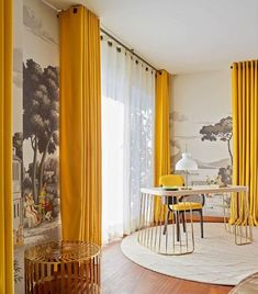 Home office defined by vibrant yellow curtains