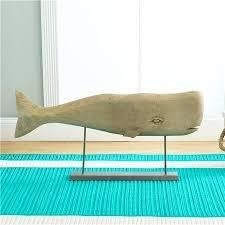 Whale watch in your own home!  Hand carved mango wood makes this guy handsome!