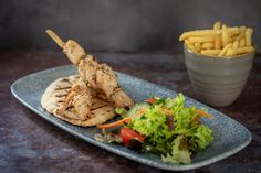 Salt & Pepper Chicken Skewers with house salad, pitta bread, chilli mayo & fries Salt And Pepper Chicken, House Salad, Gin Bar, Farm Shop, Chicken Skewers, Pitta, Tasty Dishes, Fries, Menu