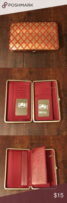 "11. Shiny Red/Gold Hananel Wallet Hananel Wallet  Perfect wallet for the gal on the go!  Colorful, compact and convenient.   Measurements are 7.5"" length x 1"" width x 4.5"" height.   Sturdy metal frame with easy-open clasp. Multi-function interior accommodates ID photo window, credit card slots, cash, checkbook holder!    Product Features: Sleek, unique & chic wallet Superb full-frame design & stylish exterior Opens easily & lies flat to allow easy access Zippered pouch Pocket on the back of…"