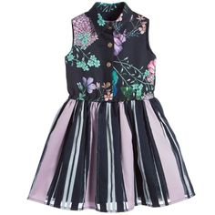 Girls black shirt dress with lilac flower 'Floral Burst' print, by Young Versace. The fitted bodice is made in a twill fabric and is fastened with gold-coloured Medusa head poppers down the front. The fully lined, striped skirt is gently gathered with elastic at the waist and includes striking, black organza panels.