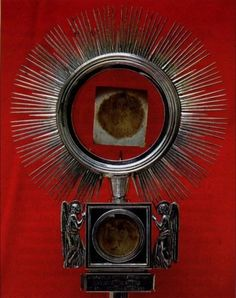 Eucharistic Miracle Cascia Italy: In 1330, at Cascia, a gravely ill peasant called Father (now Blessed) Simone Fidati so he could receive Communion. Instead of taking the ciborium with him, the priest placed a Host in a prayer book. When he reached the ill man the priest opened the book and with astonishment saw that the Host was transformed into a clot of blood and the pages of the book were marked with blood.