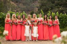 Donna Morgan Coral wedding // Colorful coral wedding flowers // Bright coral bridesmaid dresses // Photo by Lauren Belknap // Megan and Mike Mitchell's wedding