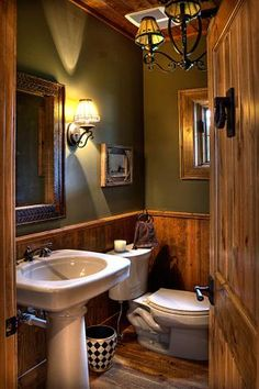 Rustic bathroom.  Beautiful light fixtures