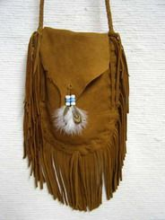"Native American Large Full-Flap Deer Hide Handbag - This wonderful large handbag is made from deer hide by Navajo artist Curtis Bitsui. The round braided strap drops from the shoulder a full 22 inches. The bag has a full flap and is finished with glass beads and feathers. The fringe is approximately 9 inches long. Certificate of Authenticity included. Dimensions: 10"" x 7.75"".  $132.95"