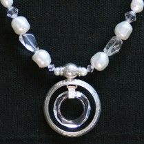 "Sterling silver and Swarovski crystal, baroque pearls, czech crystal. 17""  Silver work by Tuareg artisans in the Sahara, designed by Leslie Clark."