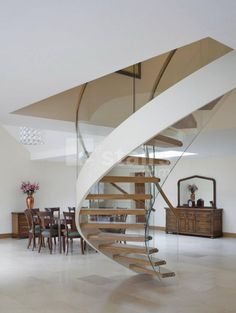 EeStairs helical staircase with glass balustrade.