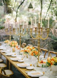 Woodland garden wedding. Orange white and gold flower arrangement. Romantic table design and place setting. #tablescape