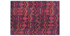 This machine-woven rug features an array of bold pinks, oranges, and blues in its fresh ikat-inspired design. The rug is made of textured polypropylene, a fiber that is durable and easy to clean. A...