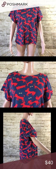 """Tsumori Chisato Cat Dog Bow Tee Name Brand: Tsumori ChisatoCondition:Pre Owned, Good condition,very little faiding (nature of fabric) no holes, stains or flaws to noteSize: Small 2(see measurements)Color: Blue with red animals and gold bowsStyle: T ShirtMaterial:60% Cotton 40% Rayon Always check the measurements, label sizes are not consistent.  Measurements are approximate, and are of item laying flat and unstreched: Waist: 21"""" Length:24.5 """" Front 26.5"""" Back Bust:22""""…"""
