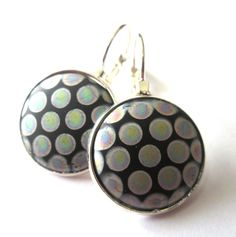 Vintage peacock glass earrings. Iridescent dots on black glass. Rare find!