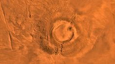 Mars Volcano, Earth's Dinosaurs Went Extinct About the Same Time. This digital-image mosaic of Mars' Tharsis plateau shows the extinct volcano Arsia Mons. It was assembled from images that the Viking 1 Orbiter took during its 1976-1980 working life at Mars. Credits: NASA/JPL/USGS
