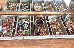 Industrial baking pan turned into a jewelry holder! I added beans to make the bracelets stand up!