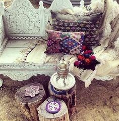 painted carved moroccan furniture with lamps, natural log tables and ikat cushions