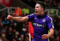 Samir Nasri of Manchester City celebrates after team-mate James Milner scored their second goal during the Barclays Premier League match between Stoke City and Manchester City at Britannia Stadium on February 11, 2015 in Stoke on Trent, England.