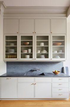 Kitchen with custom cabinets and Pietra Cordosa counters in a Brooklyn townhouse remodel (from apartments to single family house) by architect Drew Lang | Remodelista
