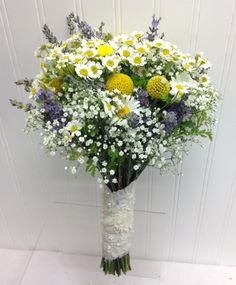 Garden Bridal Bouquet with Chamomile, Lavender, Craspedia, and Babies Breath. Designed by Wendy at Ballard Blossom Seattle Florist. Seattle Wedding Flowers.